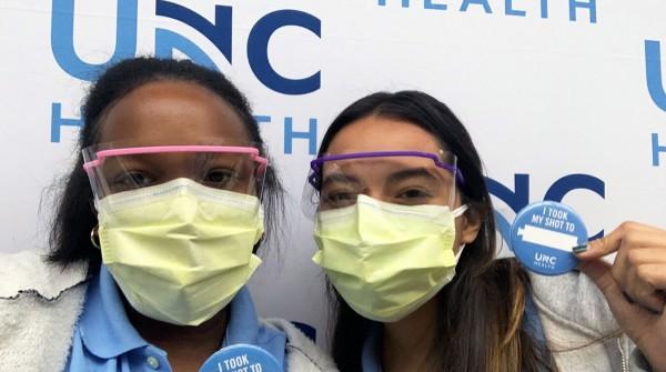 Scholars Bria Bryant and Rebecca Zasloff volunteered at the Friday Center vaccine clinic.